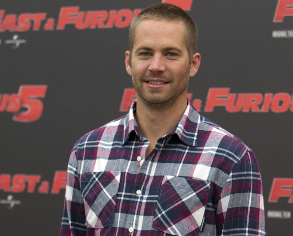 "Actor Paul Walker poses for a publicity photo for the movie ""Fast and Furious 5"" in this April 2011 photo."