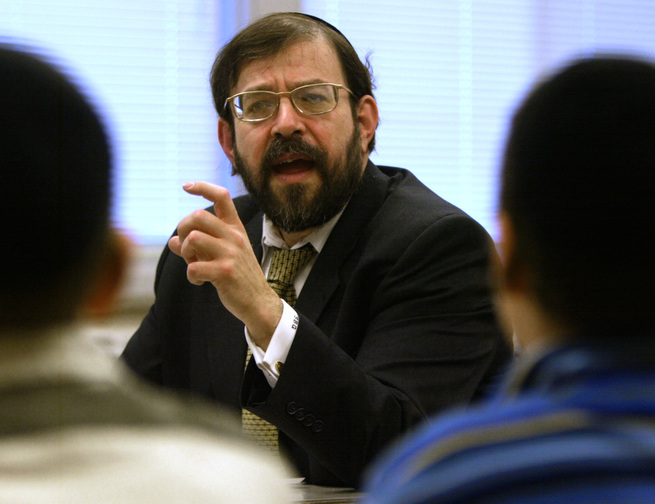 "Rabbi S. Binyomin Ginsberg is shown in a 2003 photo. The Supreme Court indicated Tuesday that it won't offer much help to frequent fliers who want to sue when airlines revoke their miles or their memberships. The justices heard the case of Ginsberg, who was stripped of his top-level ""platinum elite"" status in Northwest's WorldPerks program because the airline said he complained too much."