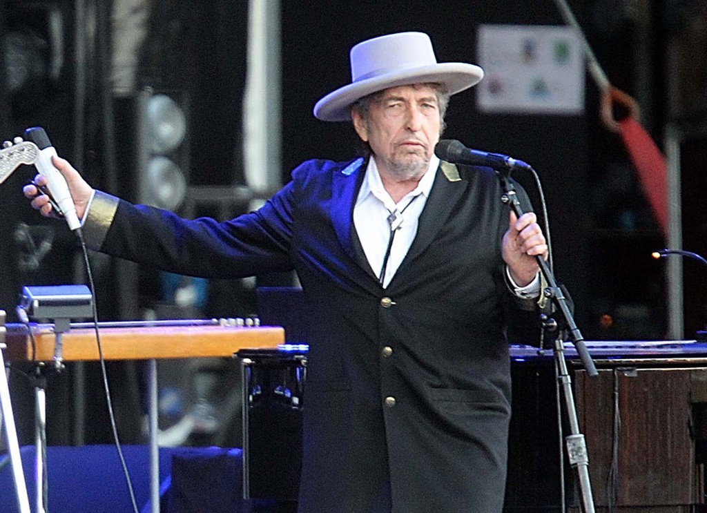 """IN this file photo, Bob Dylan performs at """"Les Vieilles Charrues"""" Festival in Carhaix, western France, in this July 2012 photo."""