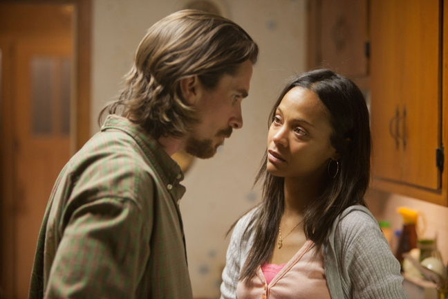 Christian Bale's character comes home from prison to discover that his girlfriend, played by Zoe Saldana, has left him for the local sheriff (played by Forest Whitaker).