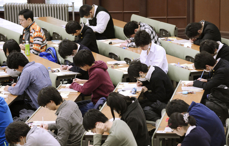 Students sit for a university admission test in Tokyo last January. Students from Shanghai, Hong Kong, Singapore, Taiwan, Japan and South Korea were among the highest-ranking groups in math, science and reading test results released Tuesday.