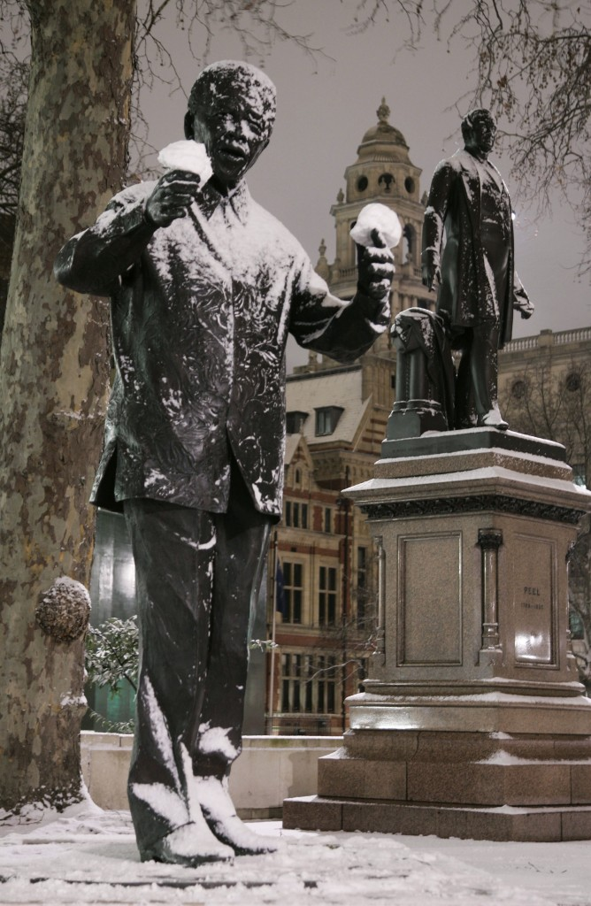 Snowballs rest on the hands of a statue of former South African President Nelson Mandela in London's Parliament Square in this Feb. 1, 2009 file photo. On Thursday, Dec. 5, 2013, Mandela died at the age of 95.