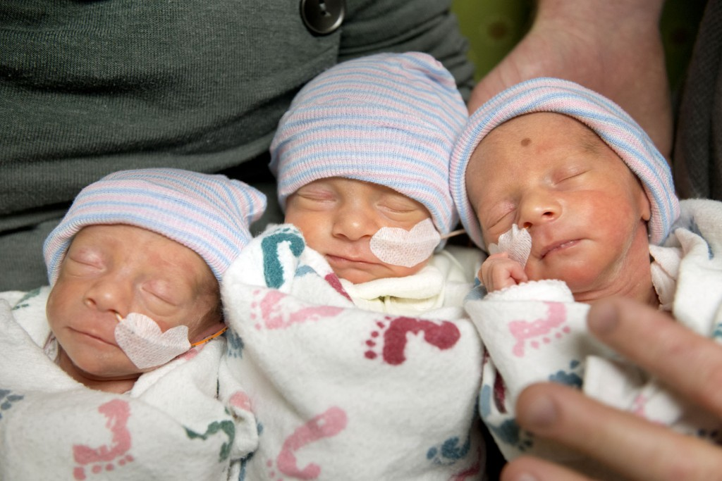 Hannah and Tom Hepner of Quincy, Calif., parents of identical triplets, hold, from left, Abby, Laurel and Brindabella in a self-care room at Sutter Memorial Hospital on Wednesday in Sacramento, Calif. The triplets were born on Nov. 22, 2013.