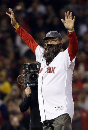 Carlton Fisk wears a beard as he throws out the ceremonial first pitch before Game 6 of baseball's World Series between the Boston Red Sox and the St. Louis Cardinals on Oct. 30 in Boston. His beard is among the memorabilia from the Red Sox World Series run now on display at the National Baseball Hall of Fame and Museum.