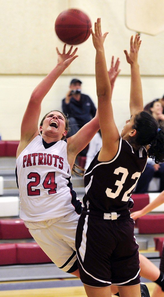 Maria Valente of Gray-New Gloucester puts up a shot over Kristina Smith of Greely while falling away. Valente, one of the top players in the state, finished with 24 points for the Patriots.