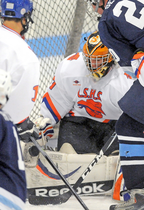 SAVE: Lawrence/Skowhegan goalie Sam Edmondson makes a save against Presque Isle in the season opener for both teams Friday at Sukee Arena in Winslow.