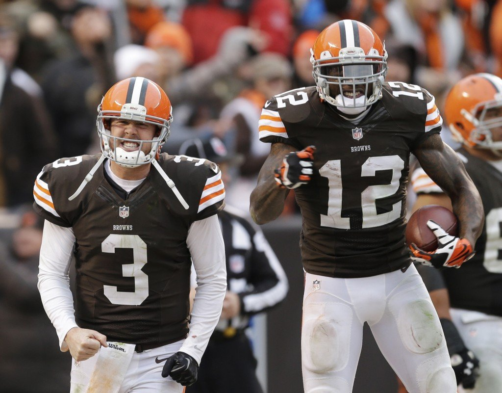 Cleveland Browns quarterback Brandon Weeden (3) celebrates with wide receiver Josh Gordon (12) after they connected on a touchdown pass in a game against the Jacksonville Jaguars on Sunday.