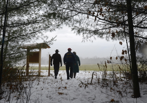 Protecting, appreciating and enjoying the landscape are the goals shared by proponents of the Hills to Sea Trail, including Buck O'Herin (left), a board member of the Sheepscot Wellspring Land Alliance, as he leads a couple hikers past the trail head kiosk in Unity.