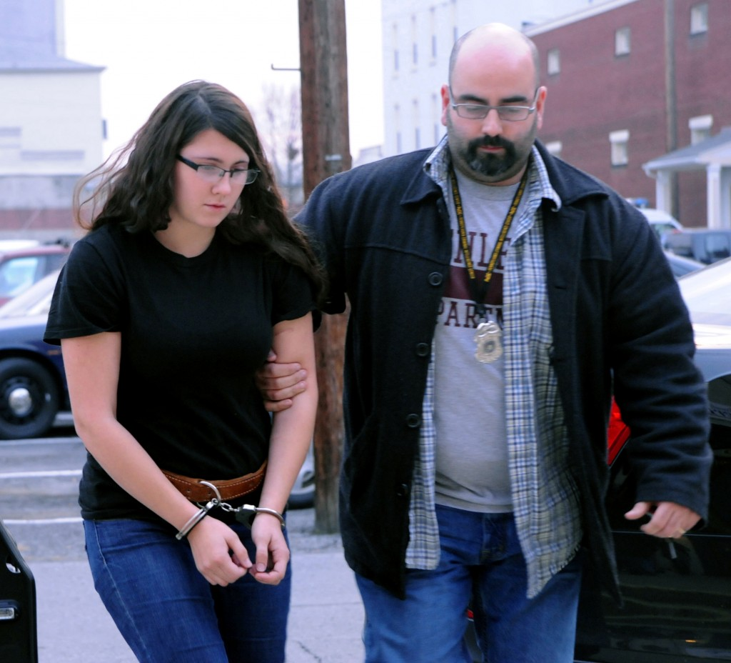 Miranda K. Barbour is led into District Judge Ben Apfelbaum's office in Sunbury, Pa., Tuesday by Sunbury policeman Travis Bremigen. Barbour is charged in the murder of Troy LaFerrara, whose body was found in a backyard in Sunbury in November.