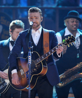 FILE - In this Nov. 24, 2013 file photo, Justin Timberlake performs on stage at the American Music Awards at the Nokia Theatre L.A. Live in Los Angeles. Timberlake was among the top nominees for the 56th annual Grammy Awards announced Friday night, Dec. 6, 2013.