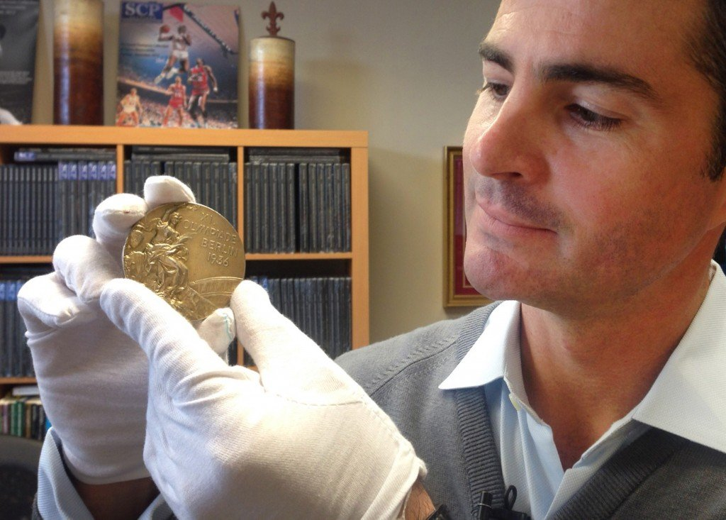 Dan Imler of SCP Auctions shows Jessie Owens gold medal from the 1936 Olympics at the SCP Auctions in Laguna Nigel, Calif. One of the four Olympic gold medals won by track and field star Jesse Owens at the 1936 Berlin Games. It sold for a record $1,466,574.