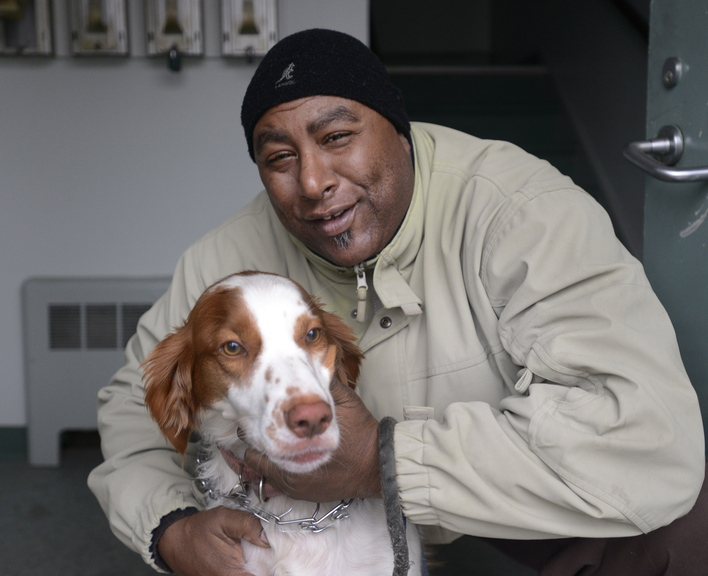 Ernesto Fernando of Portland holds his dog Boomer at his home. Fernando fought his citation for having an unleashed dog outdoors, but lost his case and was fined $75.