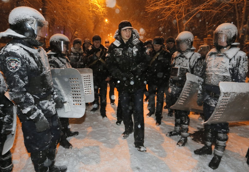 Vitali Klitschko, a Ukrainian lawmaker and chairman of the opposition party Udar, is surrounded by police as they tried to prevent possible clashes in Kiev on Monday.