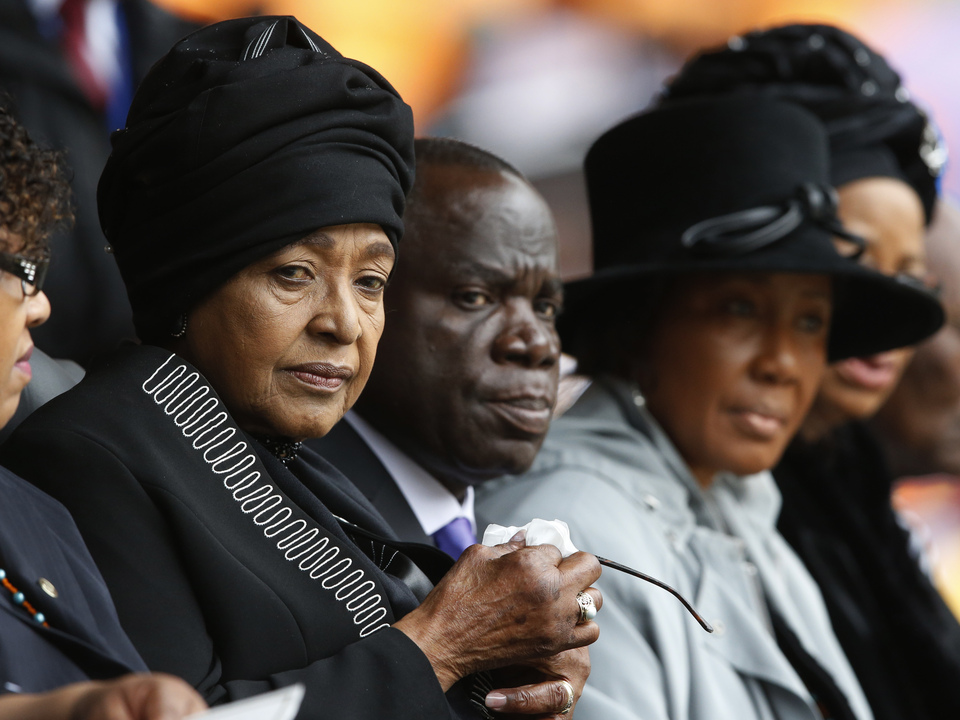 Winnie Madikizela-Mandela, left, Nelson Mandela's former wife, attends the memorial service for former South African president Nelson Mandela at the FNB Stadium in Soweto near Johannesburg, Tuesday.