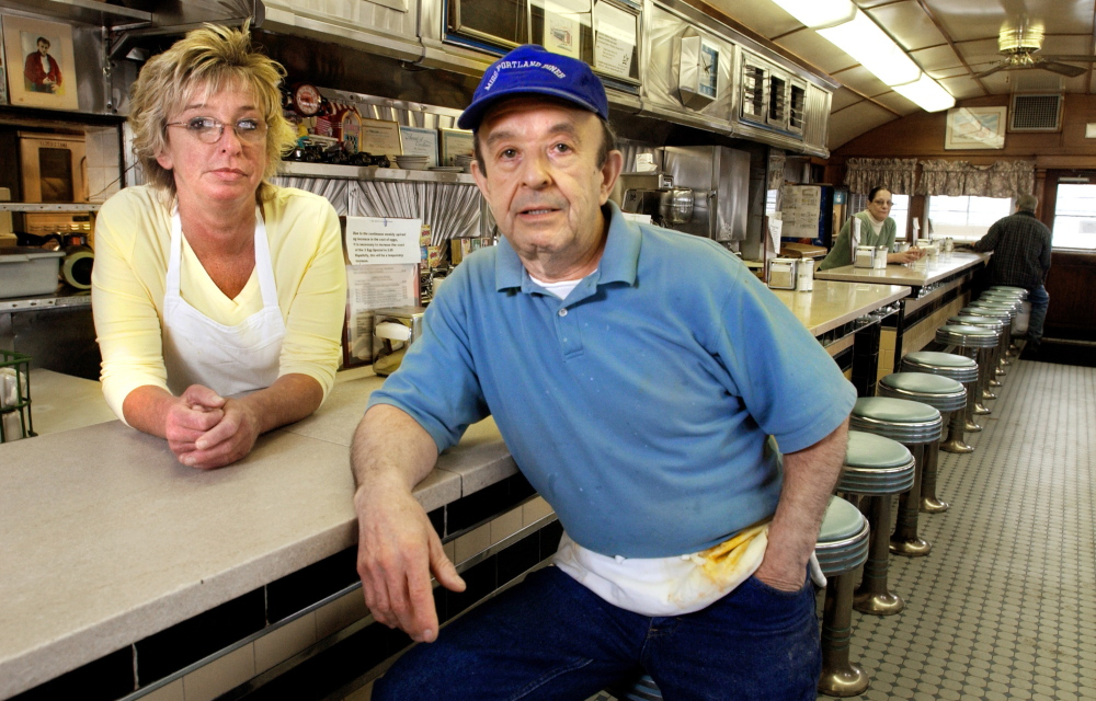 Randall Chasse and his manager, Mary Barnes, are shown in the Miss Portland diner in Portland in 2004, the year he donated it to the city. He later owned and operated the Middle Street Cafe.