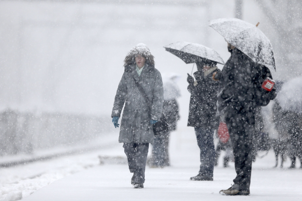 The Associated Press Commuters wait for a train in Philadelphia Tuesday morning. Accumulations of 3 to 6 inches were expected as the National Weather Service issued a winter storm warning for the Eastern Seaboard, including Baltimore, Washington, D.C., Philadelphia and Wilmington, Del.
