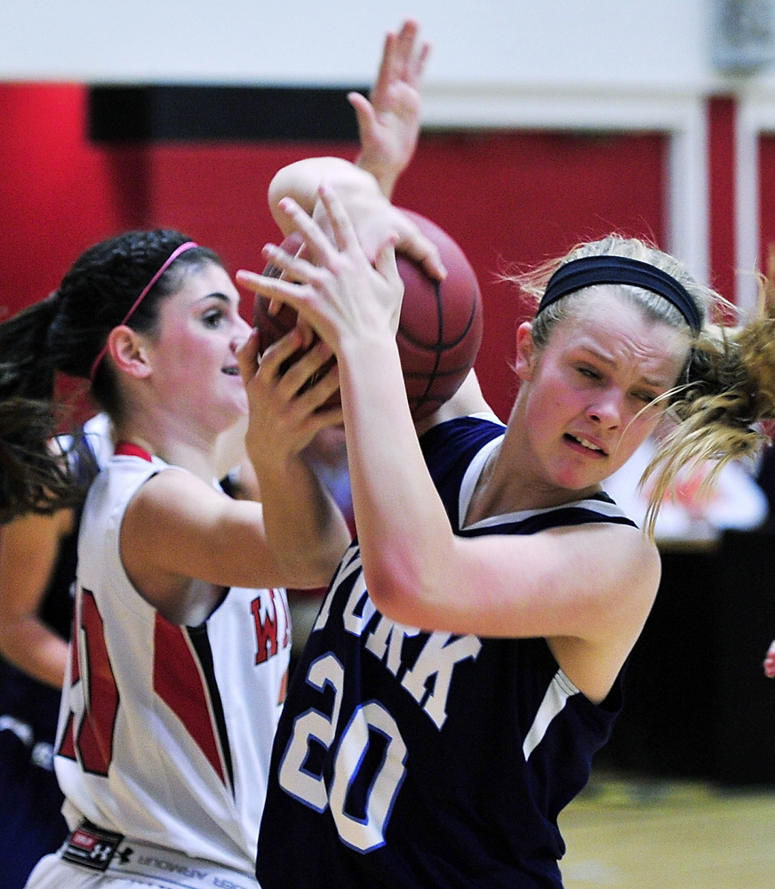Chloe Smedley of York, right, pulls down a rebound from Taryn Lambert of Wells during their Western Maine Conference game Tuesday night. Wells opened a 16-6 lead after one quarter and went on to a 57-38 victory.