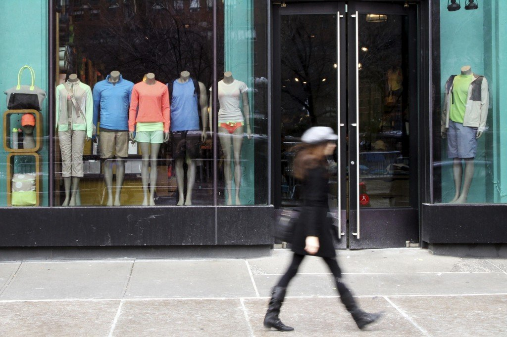 FILE - In this Tuesday, March 19, 2013, file photo, a woman walks past the Lululemon Athletica store at Union Square in New York. The company said Tuesday, Dec. 10, 2013 that Lululemon founder Chip Wilson is stepping down as chairman after raising ire with his comments about the body types of potential buyers of the retailer's yoga pants. (AP Photo/Mary Altaffer, File)