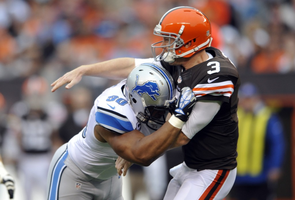 Cleveland Browns quarterback Brandon Weeden (3) is hit by Detroit Lions defensive tackle Ndamukong Suh after throwing a pass in a game in Cleveland on Oct. 13. Suh wasn't penalized on the play, but was reportedly fined by the league for the hit.
