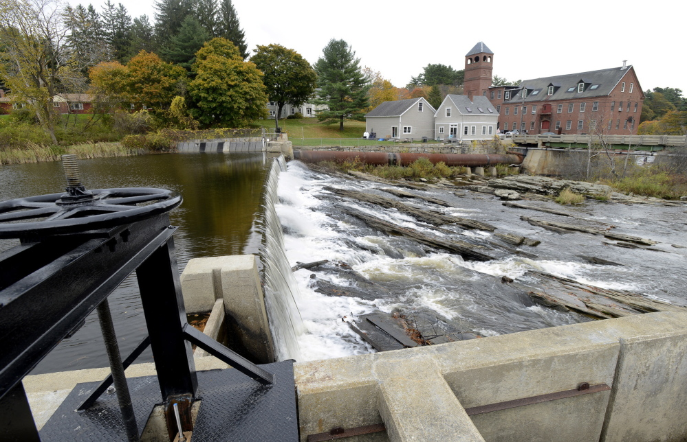 Water from the Royal River flows over the Bridge Street dam in Yarmouth, one of two dams the town is considering removing. A recent op-ed doesn't give enough credence to concerns that dam removal could wash toxins into Yarmouth Harbor, a reader says.