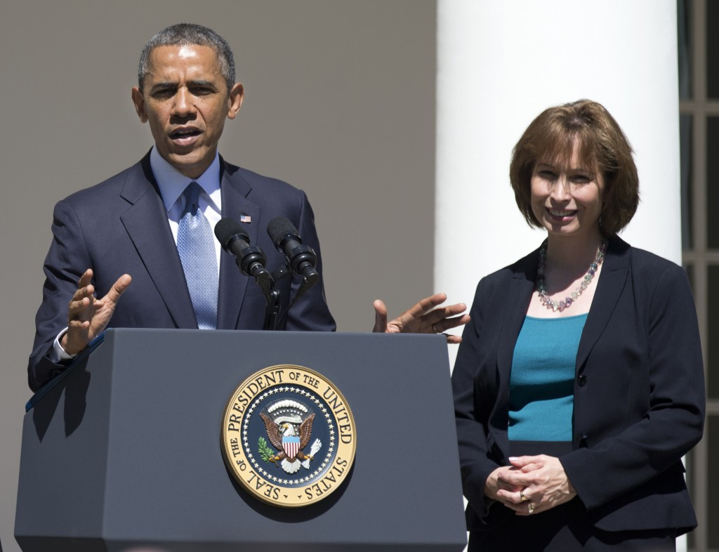 In this June 4, 2013 file photo, President Barack Obama gestures while speaking in the Rose Garden of the White House in Washington, Tuesday, June 4, 2013, to announce the judicial nominations including Patricia Ann Millett, right, to the U.S. Court of Appeals for the District of Columbia Circuit.