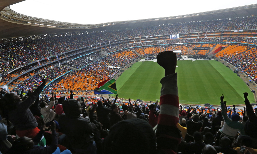 People cheer as President Obama speaks at FNB Stadium in Soweto, South Africa, on Tuesday during the national memorial service for Nelson Mandela.