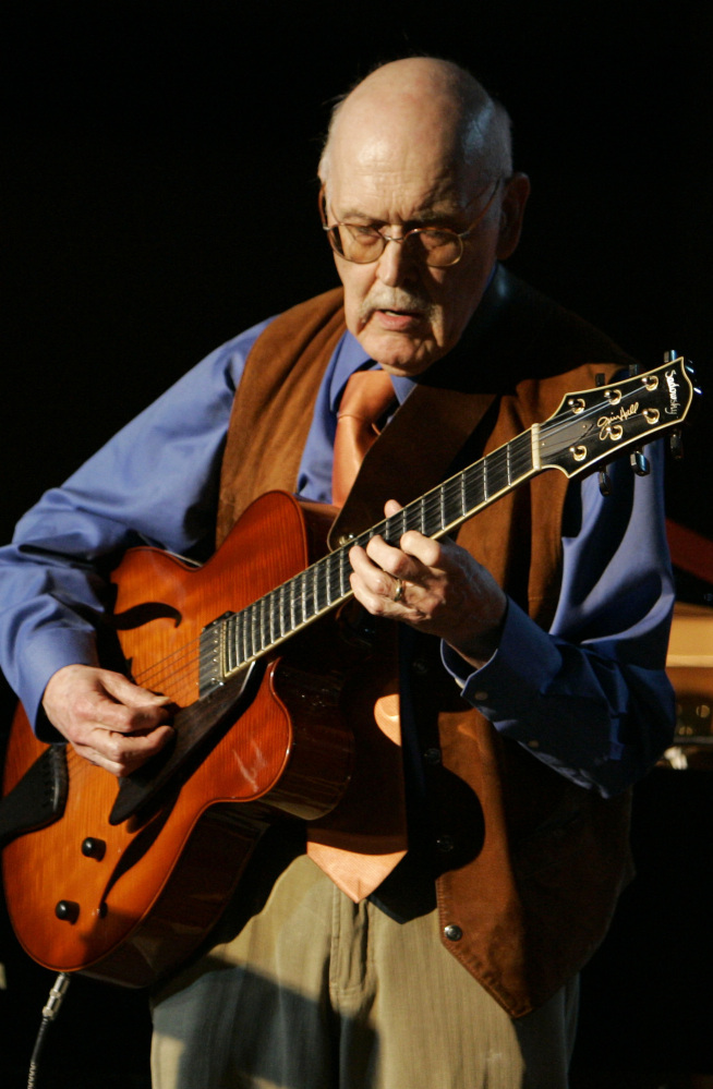 Guitarist Jim Hall, shown playing at the 50th annual Monterey Jazz Festival in California, was one of the leading jazz guitarists of the modern era.