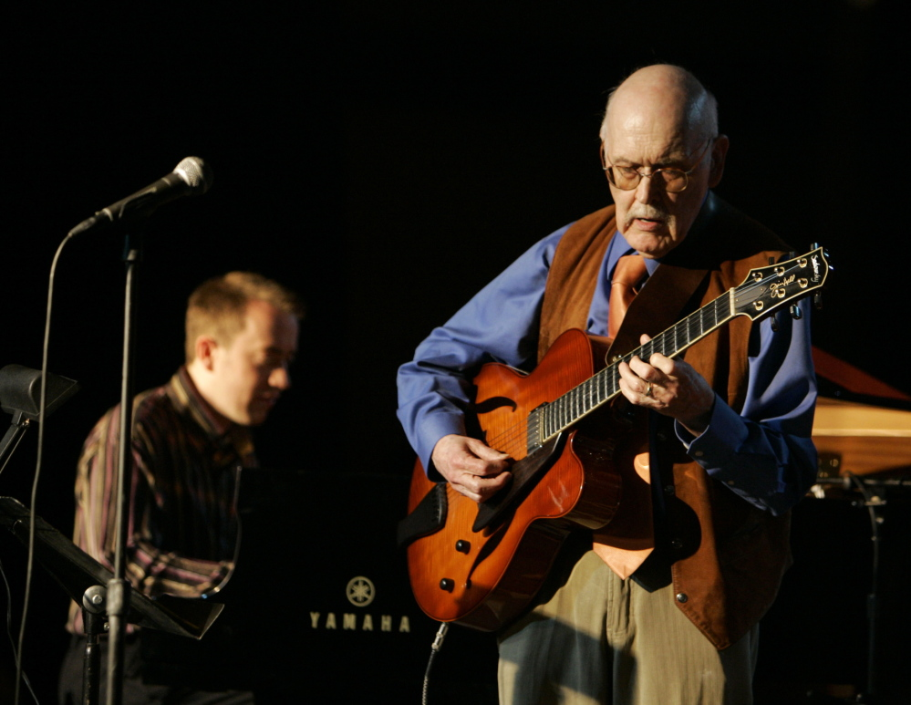 Guitarist Jim Hall plays with Geoffrey Keezer on piano during the 50th annual Monterey Jazz Festival in Monterey, Calif., in this Sept. 21, 2007, photo.