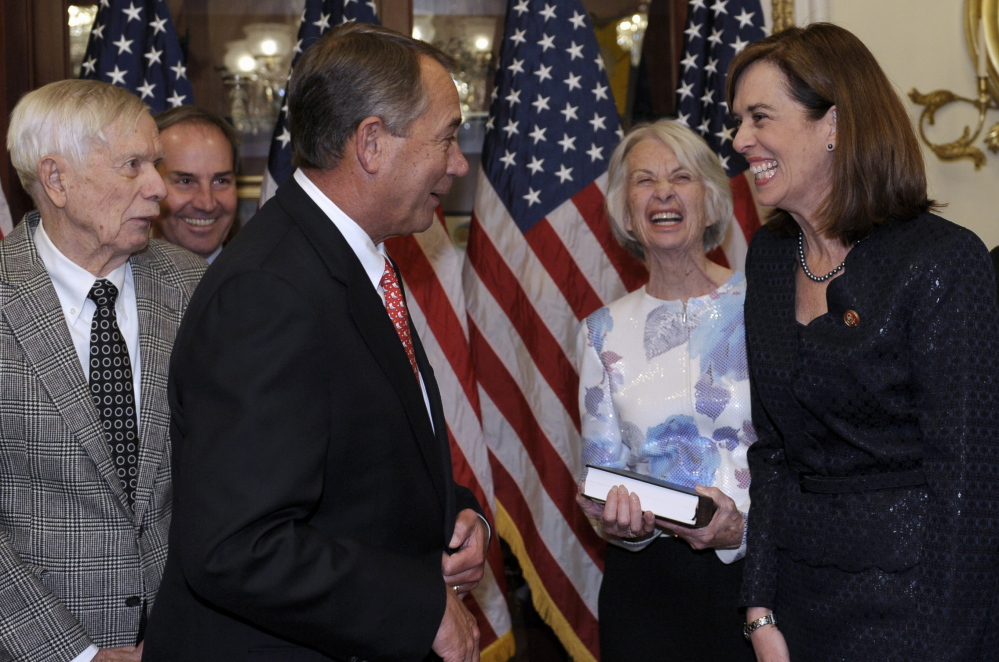 House Speaker John Boehner, R-Ohio, third from left, shares a laugh Thursday with Katherine Clark, D-Mass., before posing for a ceremonial swearing-in on Capitol Hill. Others in the photo are, from left, Clark's father, Chan Clark, husband, Rodney Dowell, and her mother, Judy Clark.