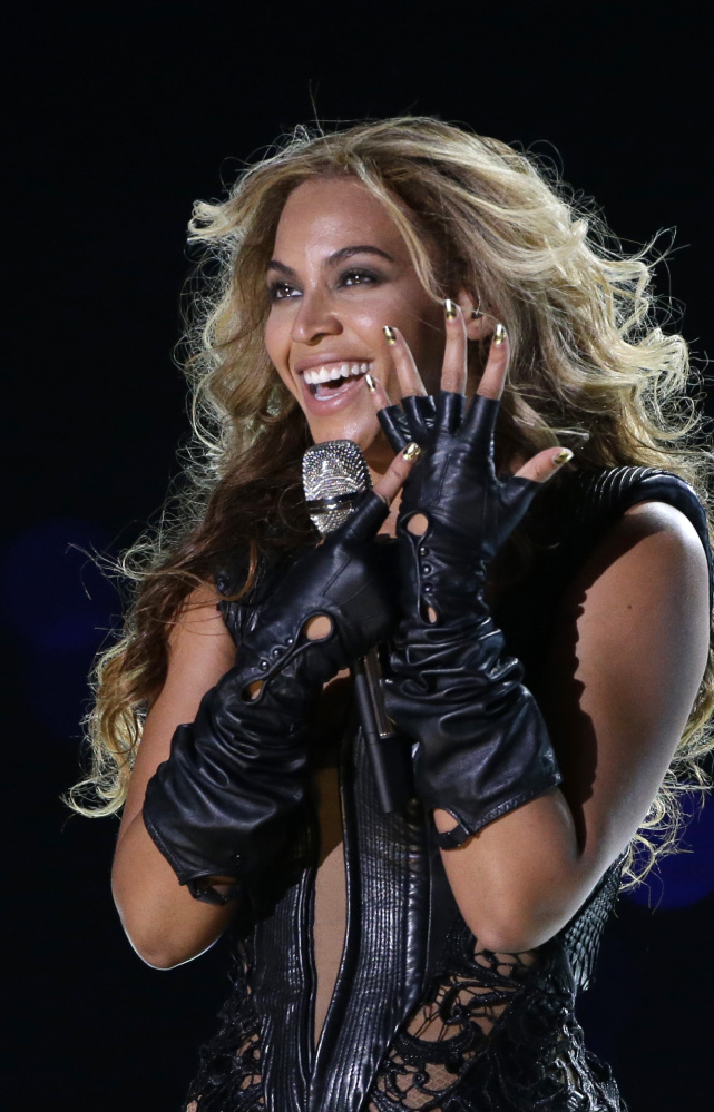 "Beyonce released her fifth self-titled album on iTunes early Friday without announcing it previously. The ""visual album"" features 14 songs and 17 videos."