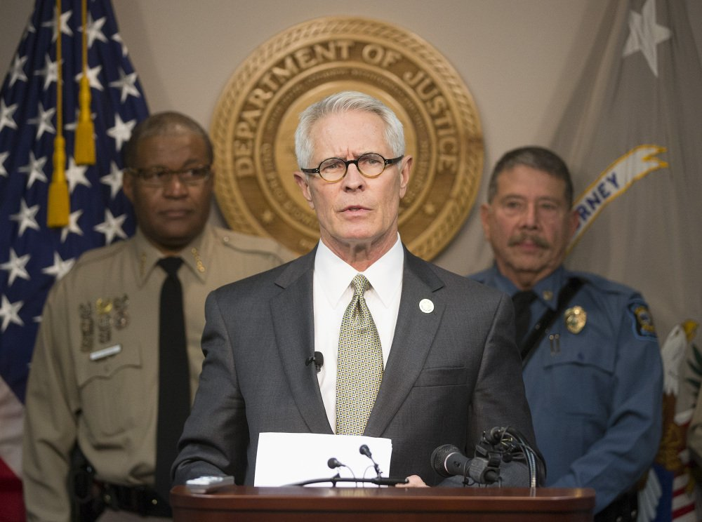 U.S. attorney Barry Grissom announces the arrest of Terry Lee Loewen, 58, of Wichita, Kansas., during a news conference . Grissom said Loewen was arrested Friday morning at Mid-Continent regional airport where he planned to drive a car that he believed was full of explosives into a terminal at the airport.