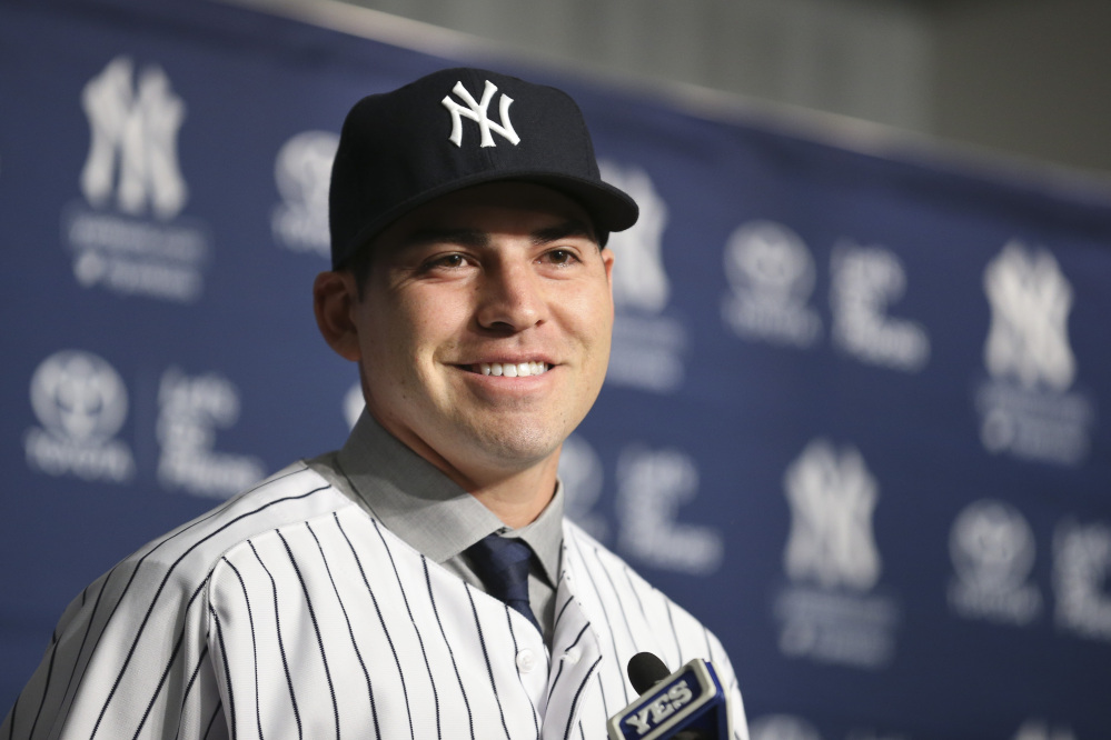 Jacoby Ellsbury smiles while taking questions during a news conference at Yankee Stadium on Friday in New York. The former Boston Red Sox outfielder agreed to a $153 million, seven-year contract with the Yankees.