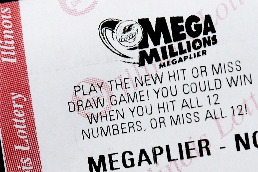 A Mega Millions lottery ticket is displayed on Friday, in Springfield, Ill. Superstition didn't deter players hoping that Friday the 13th would bring them good luck, but officials say there is no winning ticket for the $425 million jackpot.