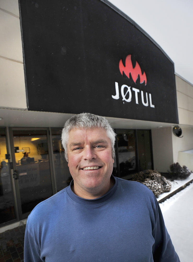 "Bret Watson is president of Jotul North America, in the Gorham Industrial Park. ""The real task,"" he said, ""is to give people in rural Maine incentives to replace their stoves."" The company's plant employs 75 people to assemble and fabricate stoves with parts shipped from Norway."