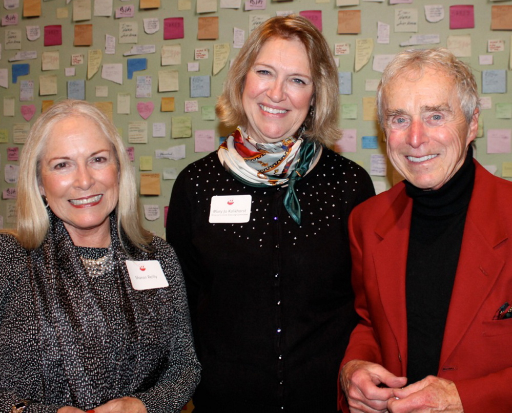 Sharon Reilly of Portland with Mary Jo Kolkhorst, a member of the Director's Circle steering committee, and playwright Frank Reilly at the Holiday Open House.