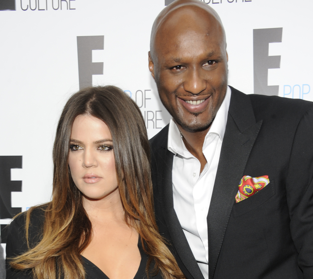 Khloe Kardashian Odom and Lamar Odom appear at an E! Network in 2012. She wants to end their four-year marriage.
