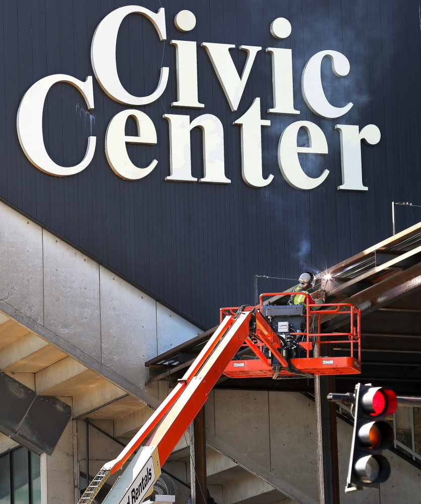 A worker welds a steel beam on the exterior of the Cumberland County Civic Center Sept. 27, a day after the Portland Pirates announced they would play all of their home games at the Androscoggin Bank Colisee in Lewiston.
