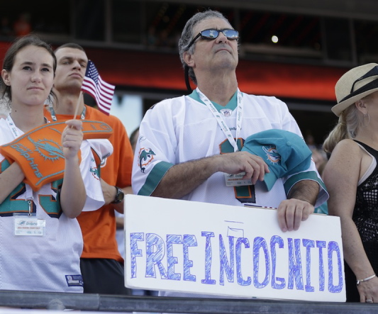 A fan shows his support for Miami Dolphins' Richie Incognito before the start of the Nov. 17 game against the San Diego Chargers in Miami Gardens, Fla.