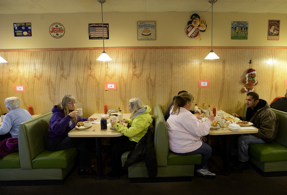 Diners fill the booths at All Day Breakfast.