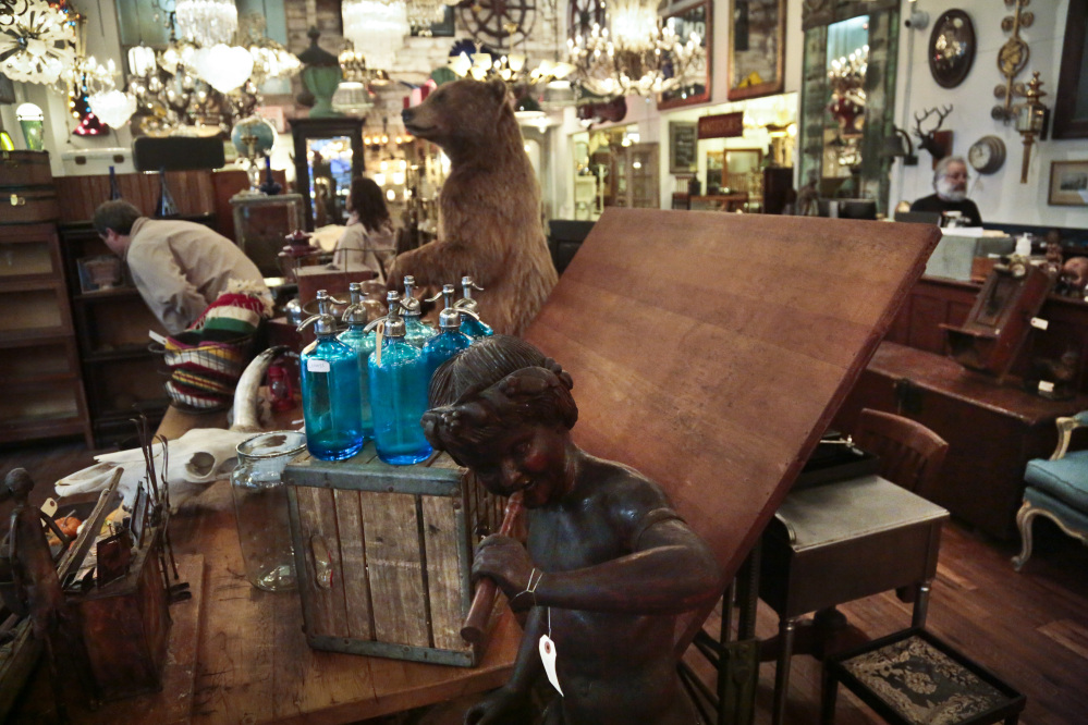 Visitors browse a collection of antiques at the Olde Good Things store in New York. The store's Christian missionary owners claim in IRS filings to be spending around $2.5 million annually on a Haiti orphanage.