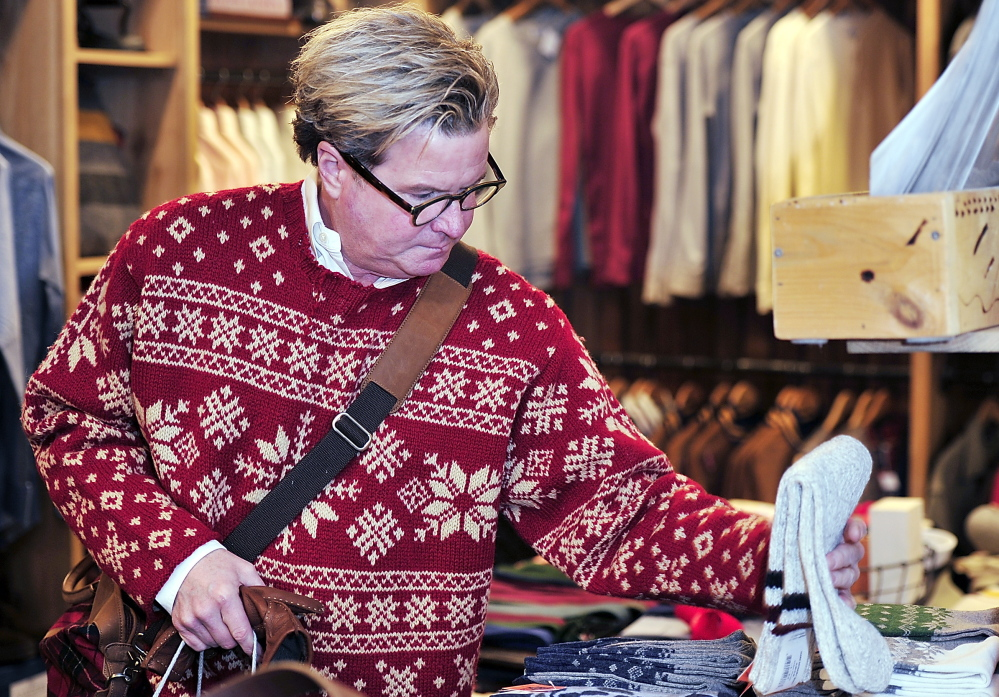 Steve Campbell of Portland shops for Christmas gifts at Portland Trading Co. on Middle Street.