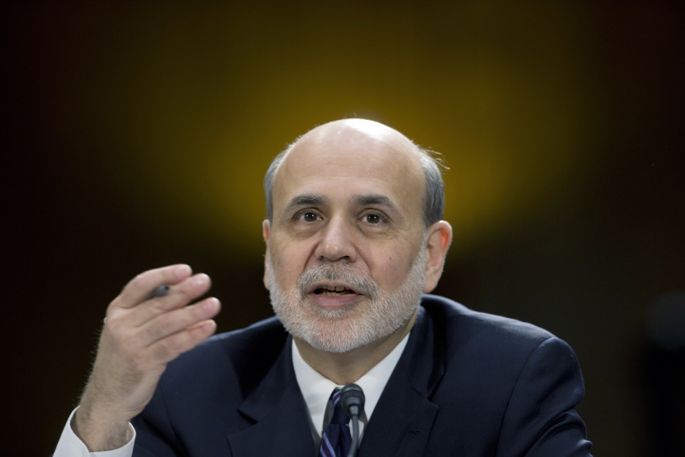 In this Feb. 26, 2013 file photo, Federal Reserve Board Chairman Ben Bernanke testifies before the Senate Banking Committee hearing on Capitol Hill in Washington. Most economists think the Fed, after meeting this week, will maintain the pace of its monthly bond purchases to keep long-term loan rates low to spur spending and growth.