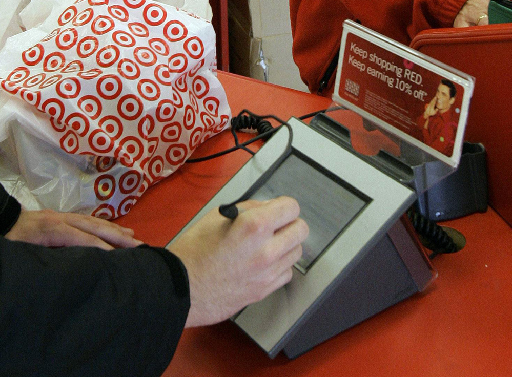 A customer signs his credit card receipt at a Target store in Tallahassee, Fla. Target says that about 40 million credit and debit card accounts customers may have been affected by a data breach that occurred at its U.S. stores between Nov. 27, 2013, and Dec. 15, 2013.