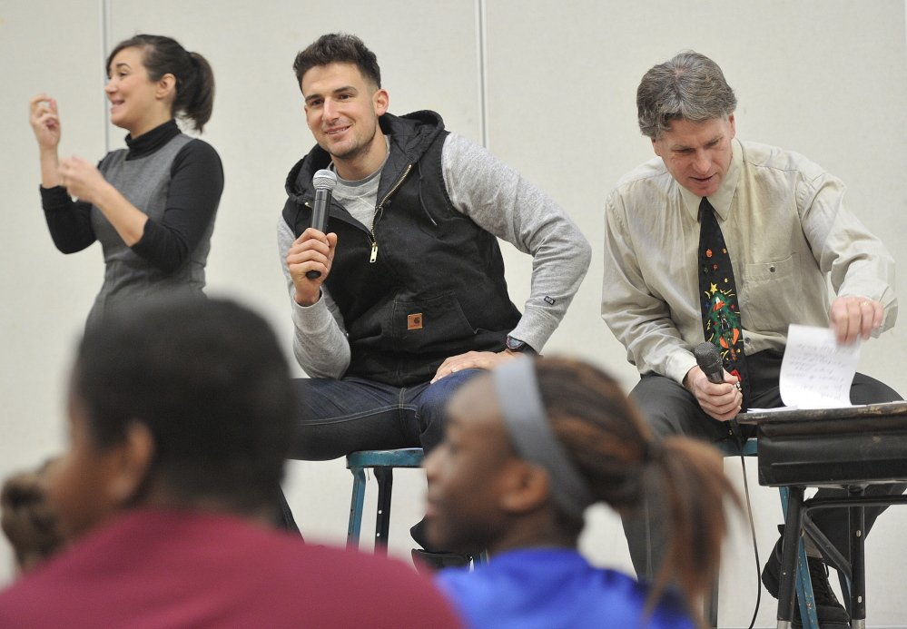 Portland native Ryan Flaherty of the Baltimore Orioles, center, answers questions from the students along with the school's principal, Stephen Rogers, right, on Thursday.