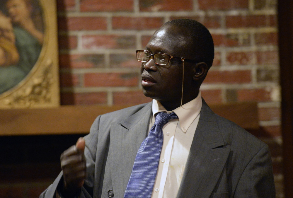 Edward Laboke of Portland, a Sudanese immigrant, speaks about the violence in South Sudan during a meeting at Trinity Episcopal Church in Portland on Saturday.
