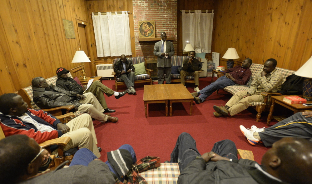 Sixteen elders of the Sudanese community in Maine discuss the unrest in South Sudan on Saturday.