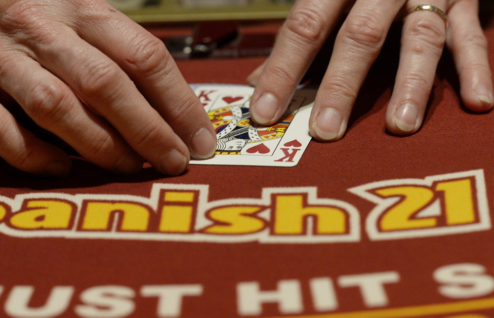 A dealer flips cards at the Spanish 21 Blackjack table at Oxford Casino on Tuesday.