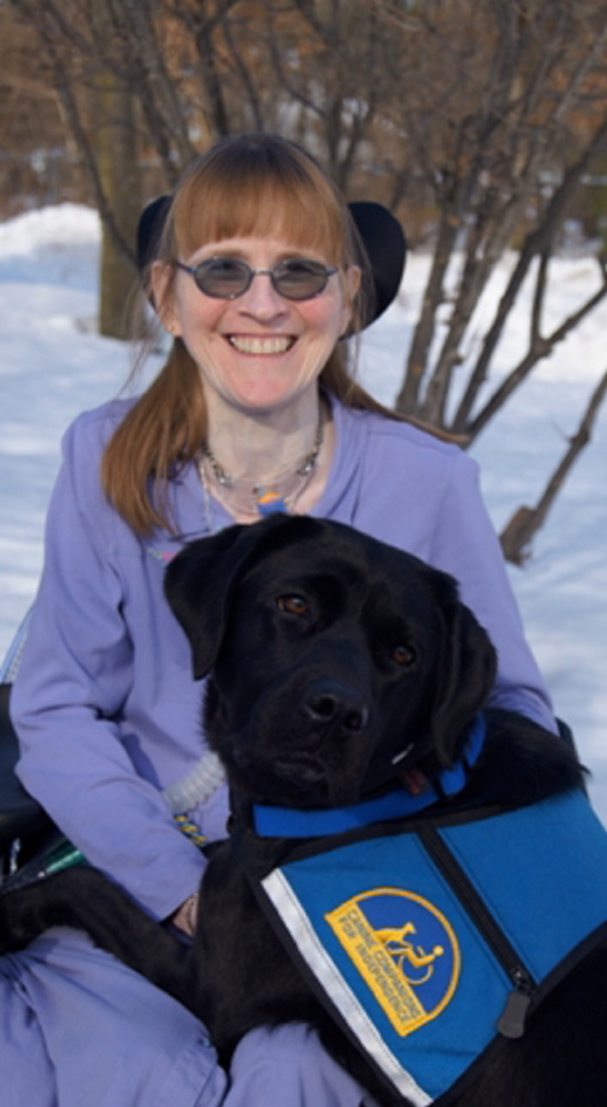Brenda Weeks of Auburn poses with Buffy, a Canine Companions for Independence service dog that she was paired with in February. The organization provides assistance dogs to children and adults with disabilities at no cost to the recipient.