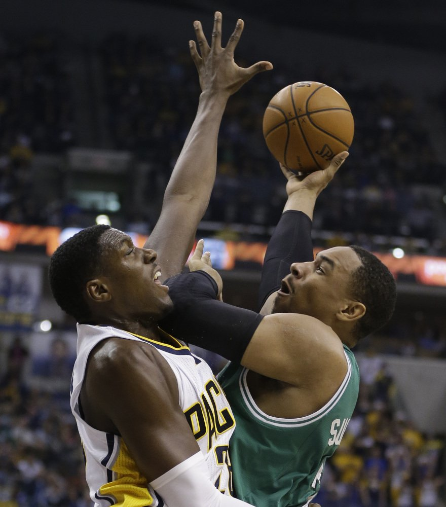 Boston's Jared Sullinger puts up a shot against the tenacious defense of Indiana's Ian Mahinmi during the first half of Sunday's game in Indianapolis.