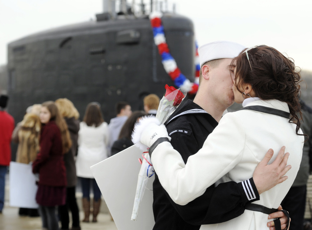 Newlyweds Electronic Technician 2nd class Tyler and Leigh Schneider embrace on the pier as the U.S. Navy attack submarine USS Missouri returns to the submarine base in Groton, Conn., after completing a six-month overseas deployment Friday. The attack submarine, one of the most advanced in the Navy fleet, conducted missions involving surveillance and reconnaissance in an area of operations around Europe on its maiden deployment.